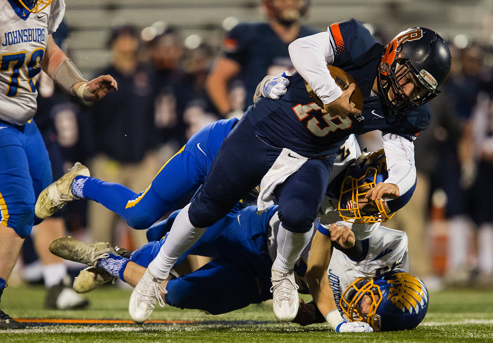 Rochester's Nic Baker racks up yards on a quarterback keeper against Johnsburg during the Class 4A championship game at Memorial Stadium in Champaign, Ill., Friday, Nov. 25, 2016.  Ted Schurter/The State Journal-Register