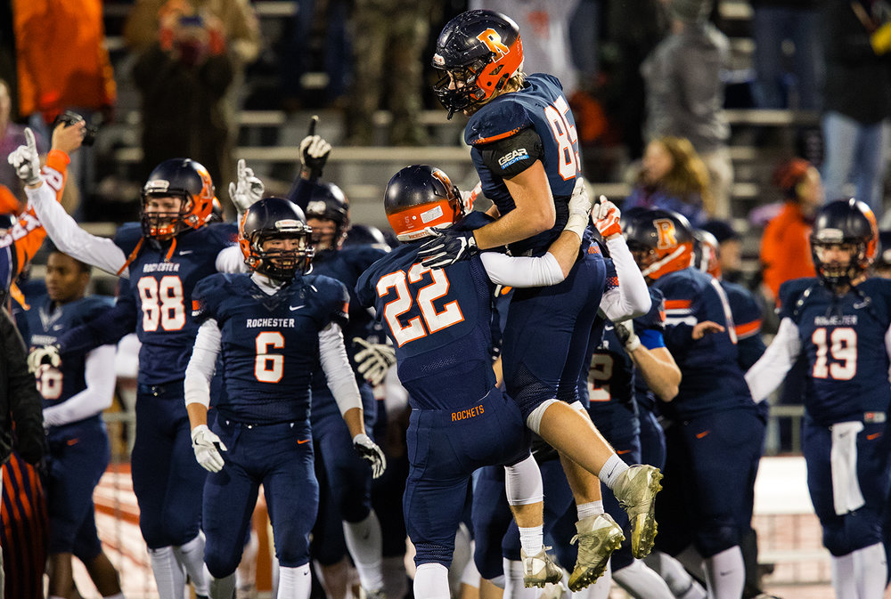 Rochester's Brice Casey (22) and Mikey McNicholas (85) celebrate as after the Rockets defeated Johnsburg during the Class 4A championship game at Memorial Stadium in Champaign, Ill., Friday, Nov. 25, 2016.  Ted Schurter/The State Journal-Register