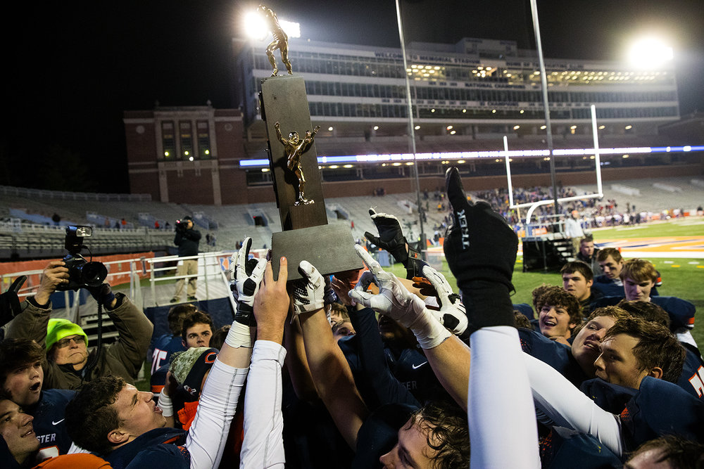 The Rochester Rockets hoist their championship trophy after defeateing Johnsburg during the Class 4A championship game at Memorial Stadium in Champaign, Ill., Friday, Nov. 25, 2016.  Ted Schurter/The State Journal-Register