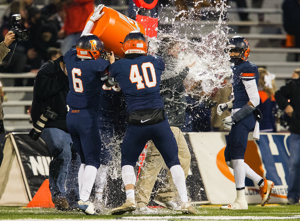 Rochester head coach Derek Leonard is doused on the sidelines as time expires in the Rockets win against Johnsburg during the Class 4A championship game at Memorial Stadium in Champaign, Ill., Friday, Nov. 25, 2016.  Ted Schurter/The State Journal-Register