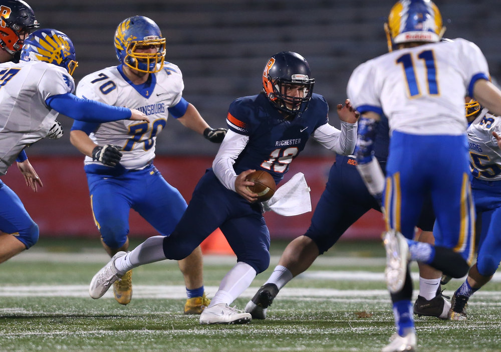 Rochester quarterback Nic Baker (19) takes off on a rush against Johnsburg in the first quarter during the IHSA Class 4A State Championship at Memorial Stadium, Friday, Nov. 25, 2016, in Champaign, Ill. Justin L. Fowler/The State Journal-Register