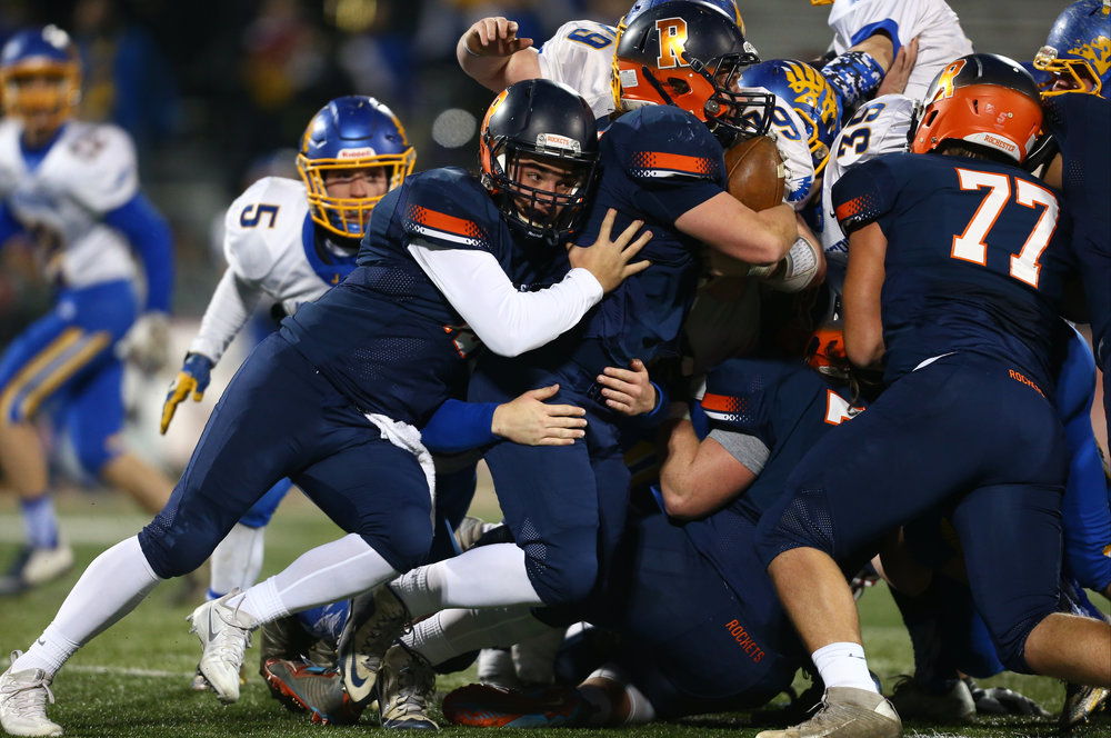 Rochester quarterback Nic Baker (19) gets a push on Rochester's Sam Baker (42) for the first down against Johnsburg in the first quarter during the IHSA Class 4A State Championship at Memorial Stadium, Friday, Nov. 25, 2016, in Champaign, Ill. Justin L. Fowler/The State Journal-Register