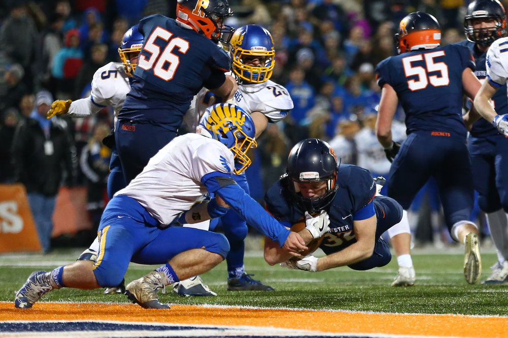 Rochester's Alec Ostermeier (32) dives into the end zone for a touchdown against Johnsburg's Blake Lemke (1) in the second quarter during the IHSA Class 4A State Championship at Memorial Stadium, Friday, Nov. 25, 2016, in Champaign, Ill. Justin L. Fowler/The State Journal-Register