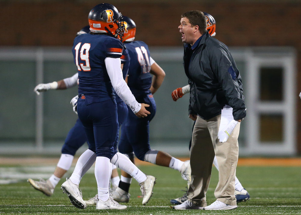 Rochester football head coach Derek Leonard screams out instructions to Rochester quarterback Nic Baker (19) after a play in the second quarter during the IHSA Class 4A State Championship at Memorial Stadium, Friday, Nov. 25, 2016, in Champaign, Ill. Justin L. Fowler/The State Journal-Register