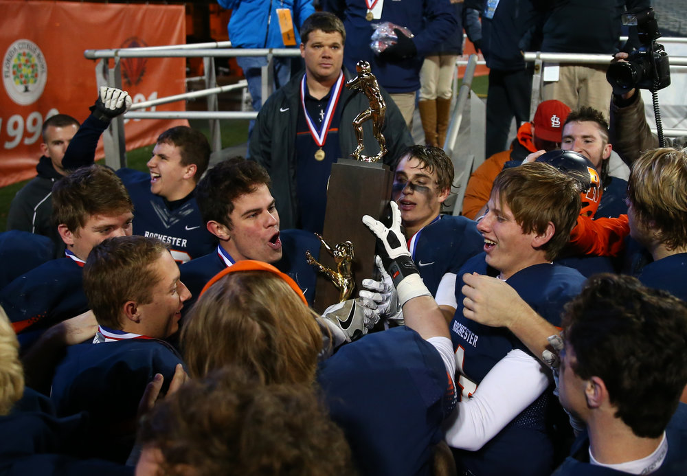 Rochester quarterback Josh Grant (14) and the Rockets celebrate with the trophy after defeating Johnsburg 38-14 in the IHSA Class 4A State Championship at Memorial Stadium, Friday, Nov. 25, 2016, in Champaign, Ill. Justin L. Fowler/The State Journal-Register