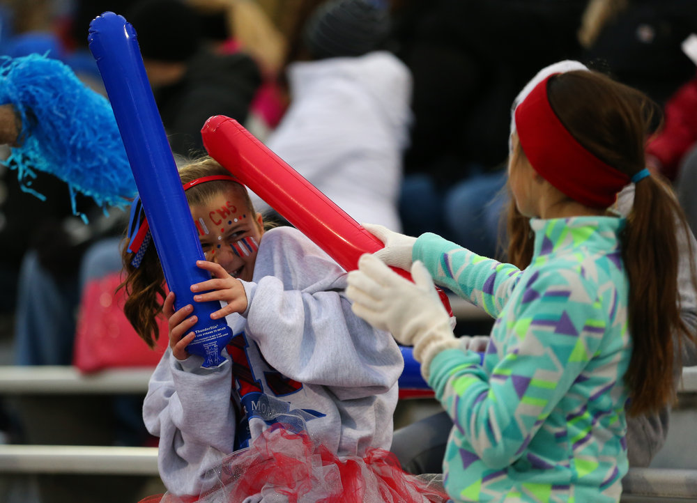 Mia Smith, 11, left, and Grace Gunning, 10, have a battle with noise makers prior to Carlinville kicking off against Elmhurst IC Catholic in the IHSA Class 3A State Championship at Memorial Stadium, Friday, Nov. 25, 2016, in Champaign, Ill. Justin L. Fowler/The State Journal-Register