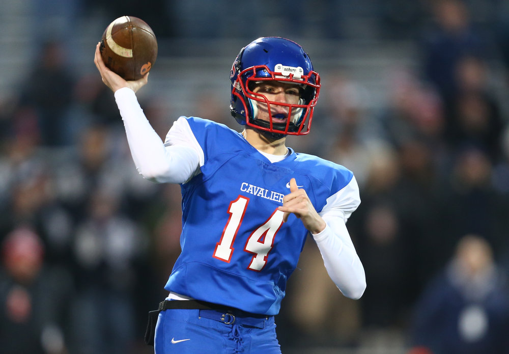 Carlinville quarterback Adam Walton (14) drops back to throw a pass against Elmhurst IC Catholic in the first quarter during the IHSA Class 3A State Championship at Memorial Stadium, Friday, Nov. 25, 2016, in Champaign, Ill. Justin L. Fowler/The State Journal-Register
