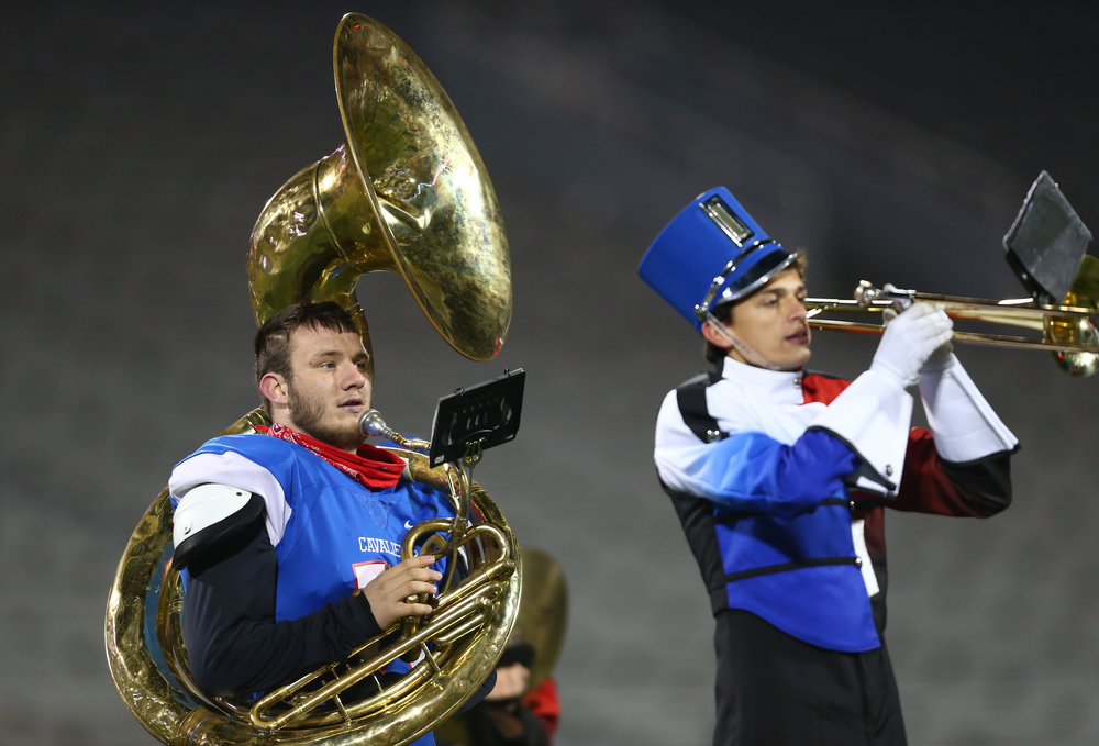 Carlinville's Zeke Gray (78) performs with the Carlinville Marching Band during halftime as the Cavaliers take on Elmhurst IC Catholic in the IHSA Class 3A State Championship at Memorial Stadium, Friday, Nov. 25, 2016, in Champaign, Ill. Justin L. Fowler/The State Journal-Register