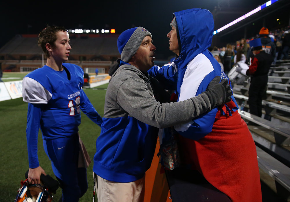 Carlinville football head coach Chad Easterday gets a hug from his wife Tammy, right, after the Cavaliers were defeated by Elmhurst IC Catholic 43-0 in the IHSA Class 3A State Championship at Memorial Stadium, Friday, Nov. 25, 2016, in Champaign, Ill. Justin L. Fowler/The State Journal-Register