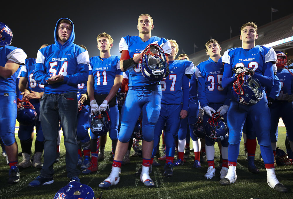 Carlinville's Brady Jamieson (88) stands with Cavaliers as they wait for their second place trophy after they were defeated by Elmhurst IC Catholic in the IHSA Class 3A State Championship at Memorial Stadium, Friday, Nov. 25, 2016, in Champaign, Ill. Justin L. Fowler/The State Journal-Register