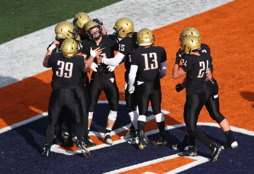 Sacred Heart-Griffin's Jack Boll (11) celebrates his touchdown with his teammates after a fumble recovery against Crystal Lake Prairie Ridge in the first half during the IHSA Class 6A State Championship at Memorial Stadium, Saturday, Nov. 26, 2016, in Champaign, Ill. Justin L. Fowler/The State Journal-Register