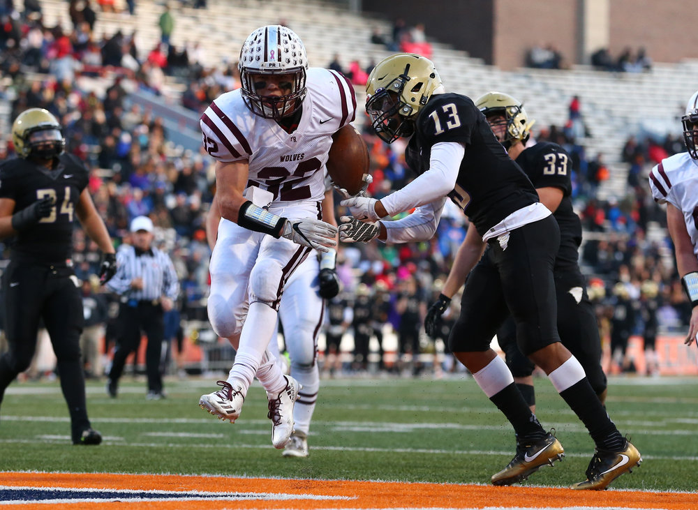 Crystal Lake Prairie Ridge's Zach Gulbransen (32) blasts in to the end zone for a touchdown against Sacred Heart-Griffin's Spencer Redd (13) in the second half during the IHSA Class 6A State Championship at Memorial Stadium, Saturday, Nov. 26, 2016, in Champaign, Ill. Justin L. Fowler/The State Journal-Register