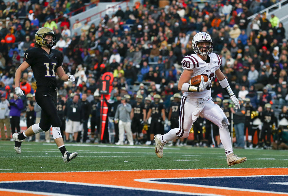 Crystal Lake Prairie Ridge's Austen Ferbet (80) goes in for a touchdown against Sacred Heart-Griffin's Jack Boll (11) in the second half during the IHSA Class 6A State Championship at Memorial Stadium, Saturday, Nov. 26, 2016, in Champaign, Ill. Justin L. Fowler/The State Journal-Register