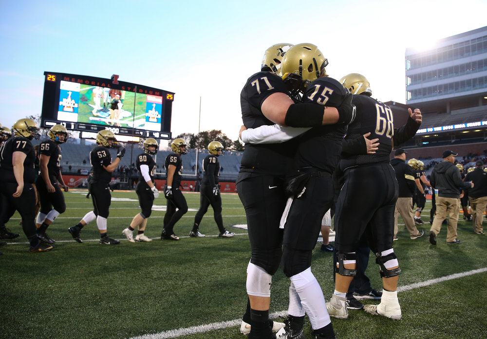 Sacred Heart-Griffin quarterback Tim Brenneisen (15) gets a hug from Sacred Heart-Griffin's John Pempek (71) after the Cyclones were defeated by Crystal Lake Prairie Ridge 48-17 in the IHSA Class 6A State Championship at Memorial Stadium, Saturday, Nov. 26, 2016, in Champaign, Ill. Justin L. Fowler/The State Journal-Register
