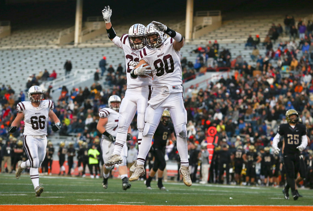 Crystal Lake Prairie Ridge's Austen Ferbet (80) celebrates his touchdown with Crystal Lake Prairie Ridge's Cole Brown (23) against Sacred Heart-Griffin in the second half during the IHSA Class 6A State Championship at Memorial Stadium, Saturday, Nov. 26, 2016, in Champaign, Ill. Justin L. Fowler/The State Journal-Register