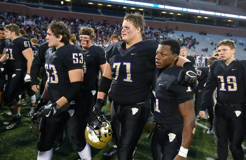 Sacred Heart-Griffin's John Pempek (71) walks towards the awards stand with Sacred Heart-Griffin's Brian Adams (1) after the Cyclones were defeated 48-17 by Crystal Lake Prairie Ridge in the IHSA Class 6A State Championship at Memorial Stadium, Saturday, Nov. 26, 2016, in Champaign, Ill. Justin L. Fowler/The State Journal-Register