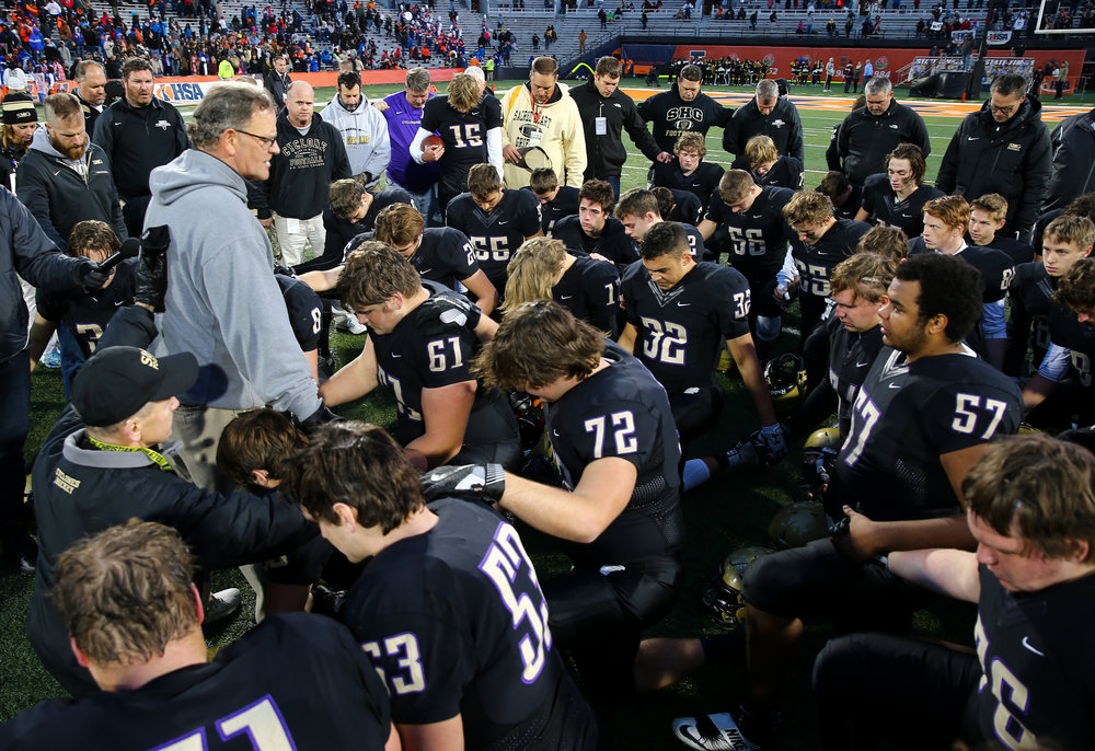 Sacred Heart-Griffin football head coach Ken Leonard holds a prayer with his team after they were defeated by Crystal Lake Prairie Ridge 48-17 in the IHSA Class 6A State Championship at Memorial Stadium, Saturday, Nov. 26, 2016, in Champaign, Ill. Justin L. Fowler/The State Journal-Register