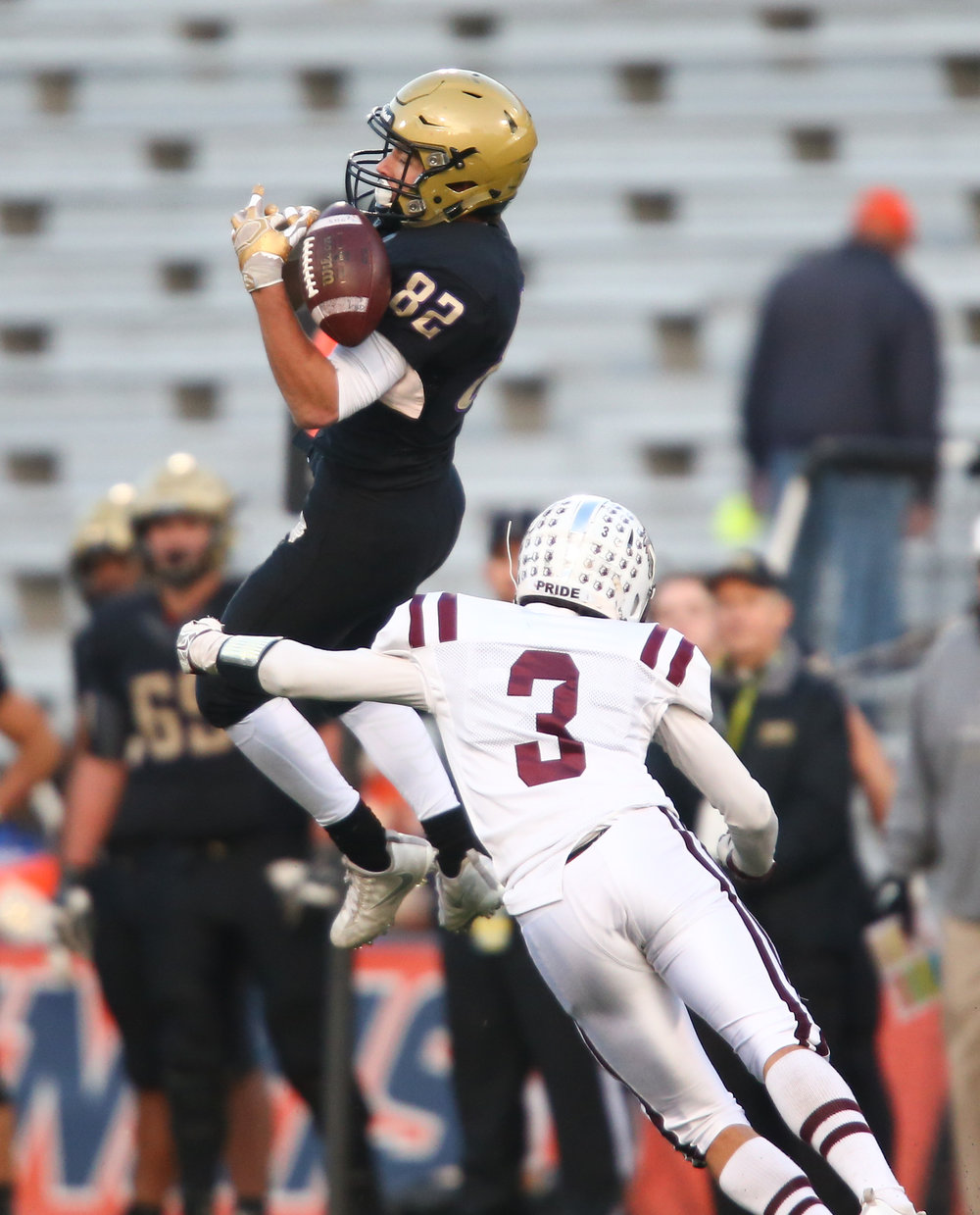 Sacred Heart-Griffin's Michael Healey (82) is unable to hold on to a pass as he is hit by Crystal Lake Prairie Ridge's James Queen (3) while in the air in the second half during the IHSA Class 6A State Championship at Memorial Stadium, Saturday, Nov. 26, 2016, in Champaign, Ill. Justin L. Fowler/The State Journal-Register
