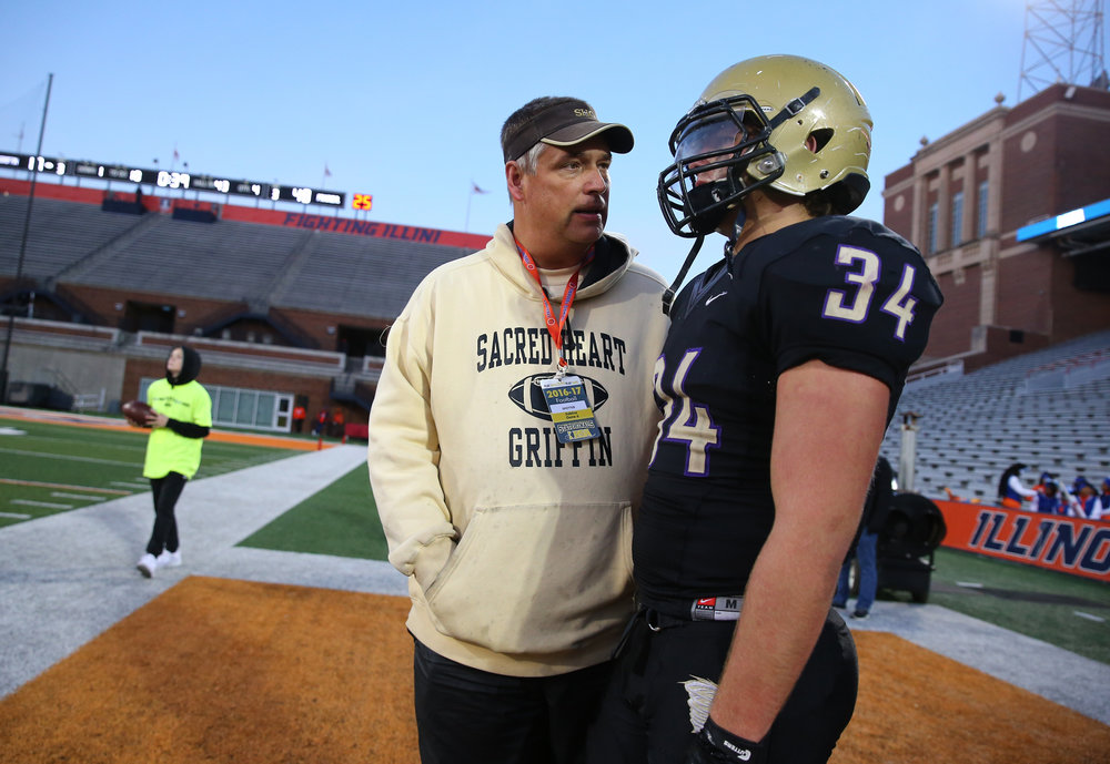 Sacred Heart-Griffin assistant coach Bob Brenneisen talks with his son Matt Brenneisen (34) as the clock winds down with the Cyclones trailing 48-17 against Crystal Lake Prairie Ridge in the IHSA Class 6A State Championship at Memorial Stadium, Saturday, Nov. 26, 2016, in Champaign, Ill. Justin L. Fowler/The State Journal-Register
