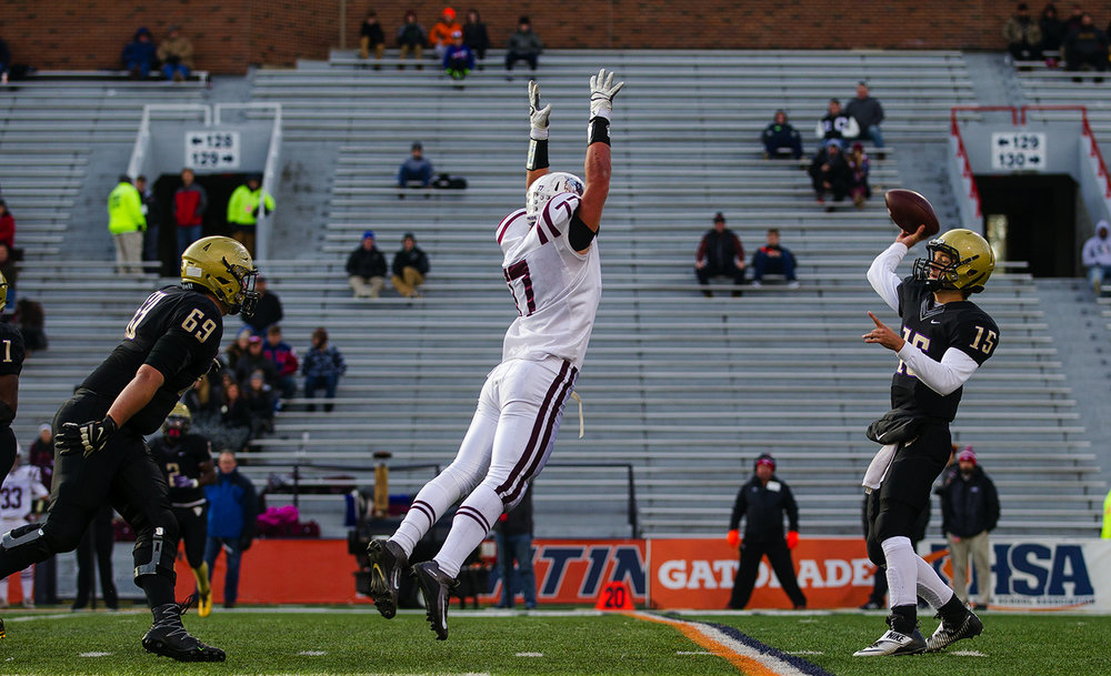 Prairie Ridge's Jeffrey Jenkins pressures Sacred Heart-Griffin quarterback Tim Brenneisen as he throws a pass during the Class 6A championship game at Memorial Stadium in Champaign, Ill., Friday, Nov. 26, 2016.