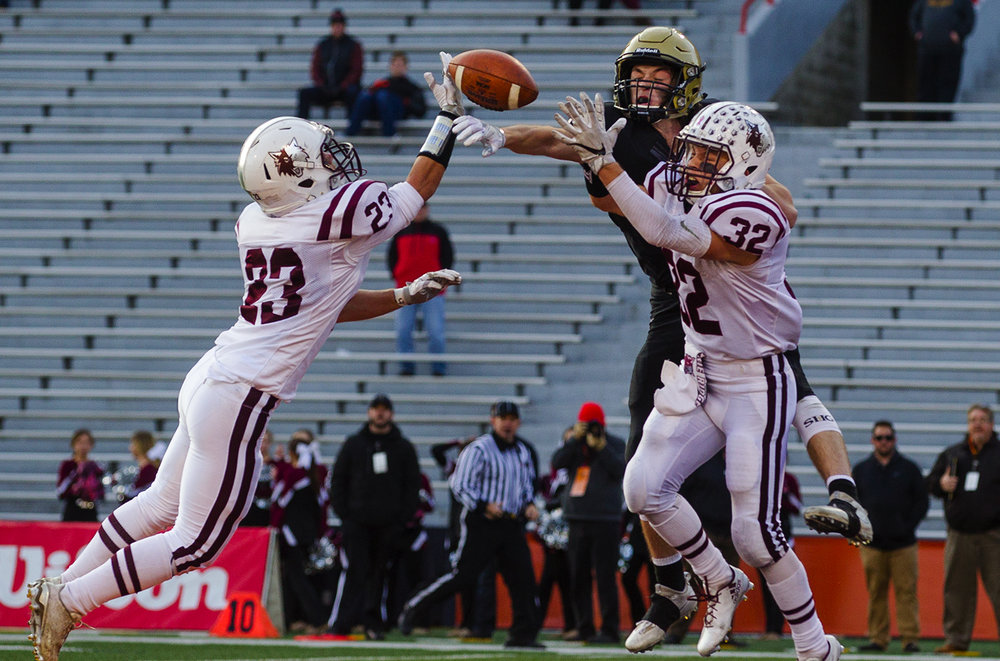 Sacred Heart-Griffin's Jack Boll breaks up a pass in the endzone between Prairie Ridge's Cole Brown and Zach Gulbransen during the Class 6A championship game at Memorial Stadium in Champaign, Ill., Friday, Nov. 26, 2016.