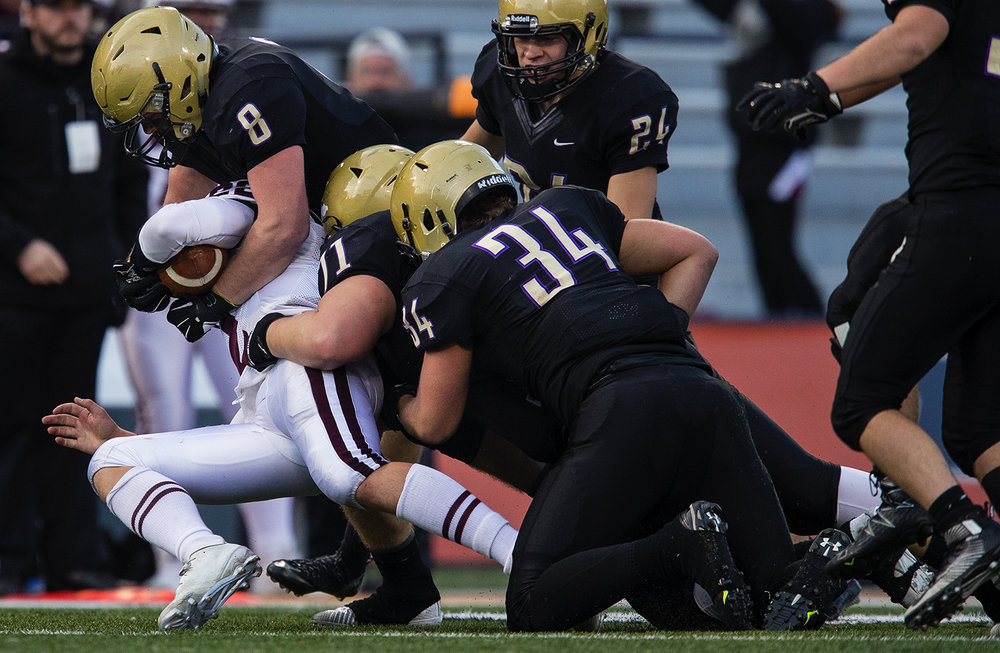 Sacred Heart-Griffin's Andrew Fiaush, John Pempek and Matt Brenneisen bring down Prairie Ridge quarterback Samson Evans during the Class 6A championship game at Memorial Stadium in Champaign, Ill., Friday, Nov. 26, 2016.