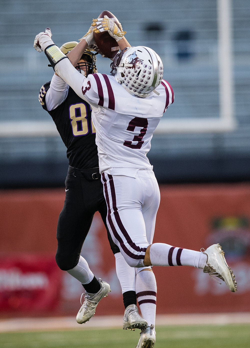 Sacred Heart-Griffin's Nick Stirens grabs a pass over Prairie Ridge's James Queen during the Class 6A championship game at Memorial Stadium in Champaign, Ill., Friday, Nov. 26, 2016.