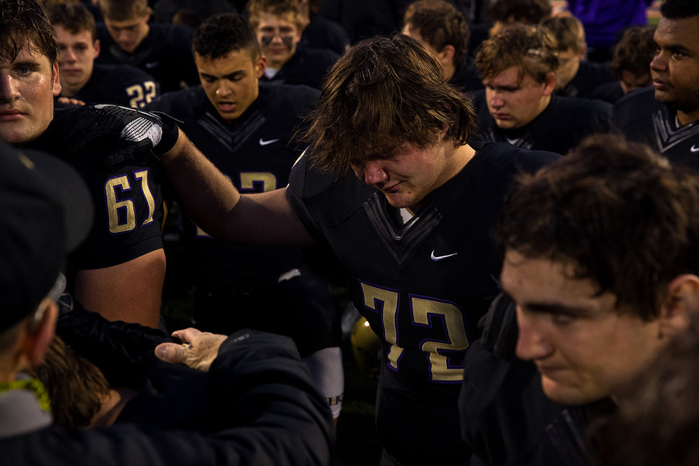 Sacred Heart-Griffin's Joey Patterson and his teammates bow in prayer before leaving the field after losing to Prairie Ridge during the Class 6A championship game at Memorial Stadium in Champaign, Ill., Friday, Nov. 26, 2016. Ted Schurter/The State Journal-Register