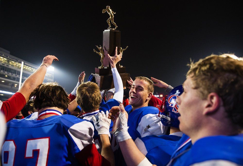 The Carlinville Cavaliers hoist their second place trophy after losing to Elmhurst during the Class 3A championship game at Memorial Stadium in Champaign, Ill., Friday, Nov. 25, 2016. Ted Schurter/The State Journal-Register