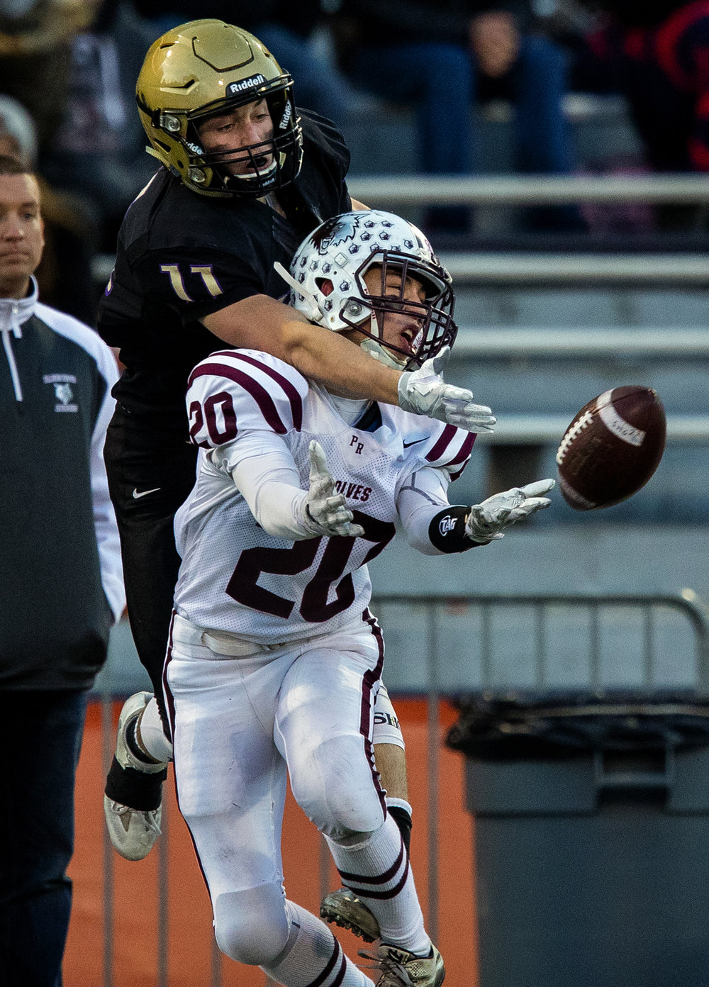 Sacred Heart-Griffin's Jack Boll is blocked by Prairie Ridge's Justin Mikolajczewski as he tries to catch a pass during the Class 6A championship game at Memorial Stadium in Champaign, Ill., Friday, Nov. 26, 2016.