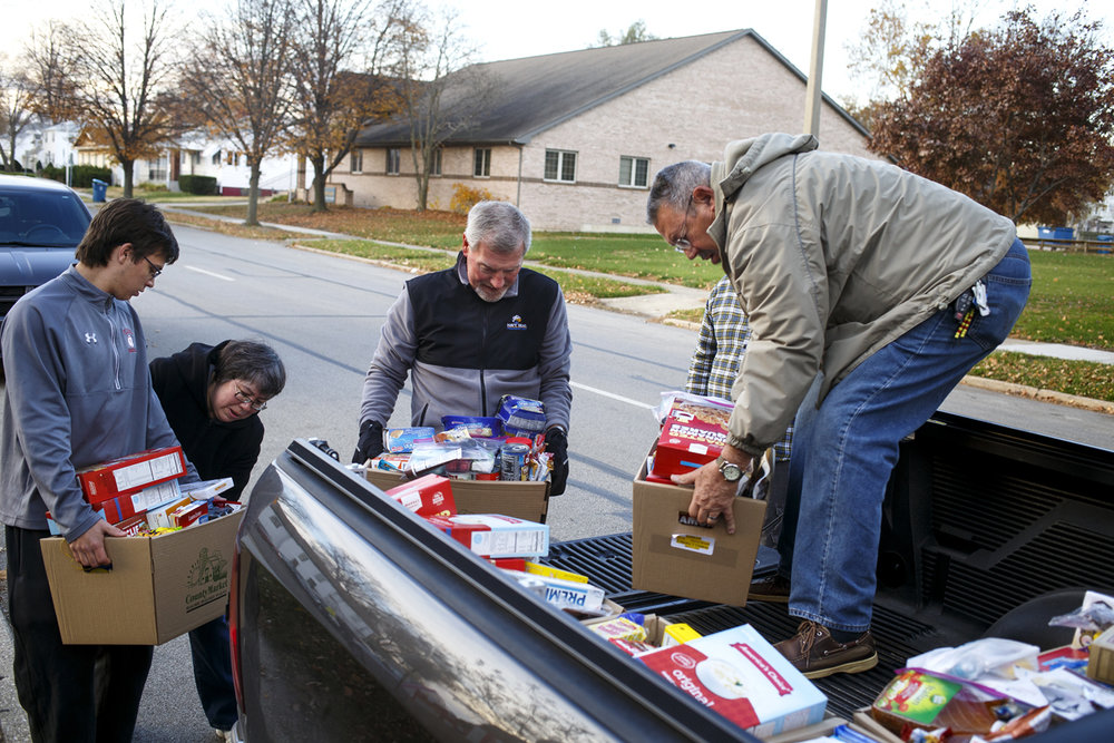 Food baskets headed to Kumler Outreach Ministries are loaded into a truck Tuesday, Nov. 22, 2016 in front of Temple B'rith Sholom. From left are Garrett Young, Sharon Brown, executive director of Kumler, Mike Dickson and Paul Kramer. For the 30th year, a partnership between members of the Temple and First Congregational Church assembled enough baskets to provide a Thanksgiving meal for more than 1,400 people. Rich Saal/The State Journal-Register