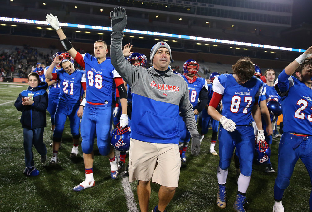 Carlinville football head coach Chad Easterday and the Cavaliers salute their fans after being defeated by Elmhurst IC Catholic 43-0 in the IHSA Class 3A State Championship at Memorial Stadium, Friday, Nov. 25, 2016, in Champaign, Ill. Justin L. Fowler/The State Journal-Register