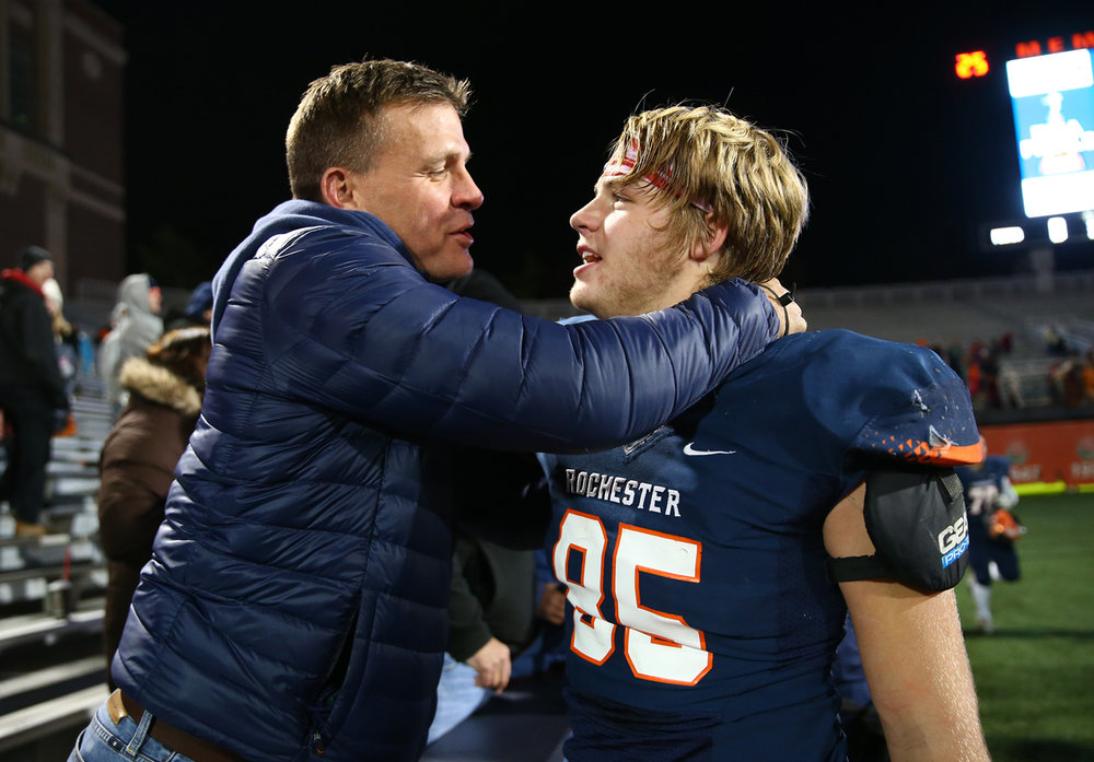 Rochester's Mikey McNicholas (85) celebrates with his father, Mike McNicholas after the Rockets defeated Johnsburg 38-14 in the IHSA Class 4A State Championship at Memorial Stadium, Friday, Nov. 25, 2016, in Champaign, Ill. Justin L. Fowler/The State Journal-Register