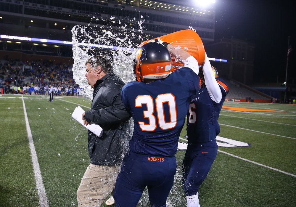 Rochester football head coach Derek Leonard gets a ice bath from his players as the Rockets win their sixth championship against Johnsburg in the IHSA Class 4A State Championship at Memorial Stadium, Friday, Nov. 25, 2016, in Champaign, Ill. Justin L. Fowler/The State Journal-Register