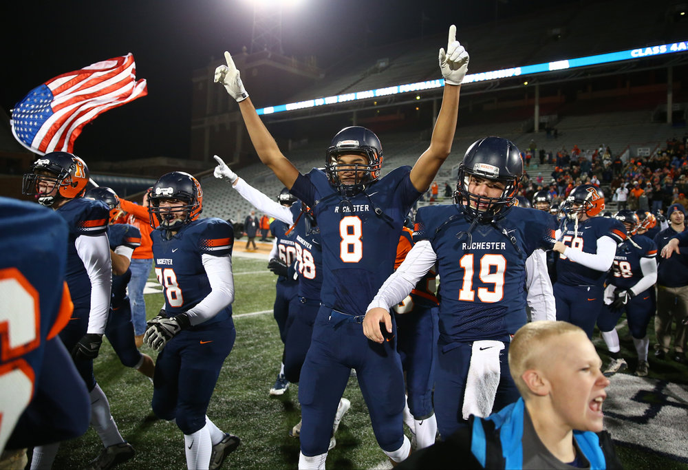 Rochester's Collin Stallworth (8) and Rochester quarterback Nic Baker (19)  begin to celebrate after the Rockets defeated Johnsburg 38-14 in the IHSA Class 4A State Championship at Memorial Stadium, Friday, Nov. 25, 2016, in Champaign, Ill. Justin L. Fowler/The State Journal-Register