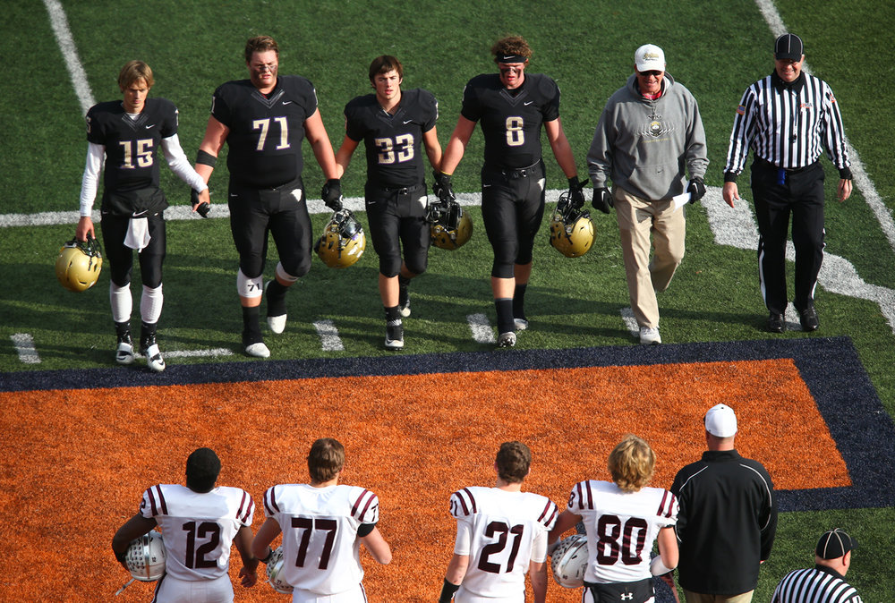 Sacred Heart-Griffin quarterback Tim Brenneisen (15), John Pempek (71), Roger Dondanville (33), Andrew Fiaush (8) and Sacred Heart-Griffin football head coach Ken Leonard come out to meet Crystal Lake Prairie Ridge prior to kick off during the IHSA Class 6A State Championship at Memorial Stadium, Saturday, Nov. 26, 2016, in Champaign, Ill. Justin L. Fowler/The State Journal-Register