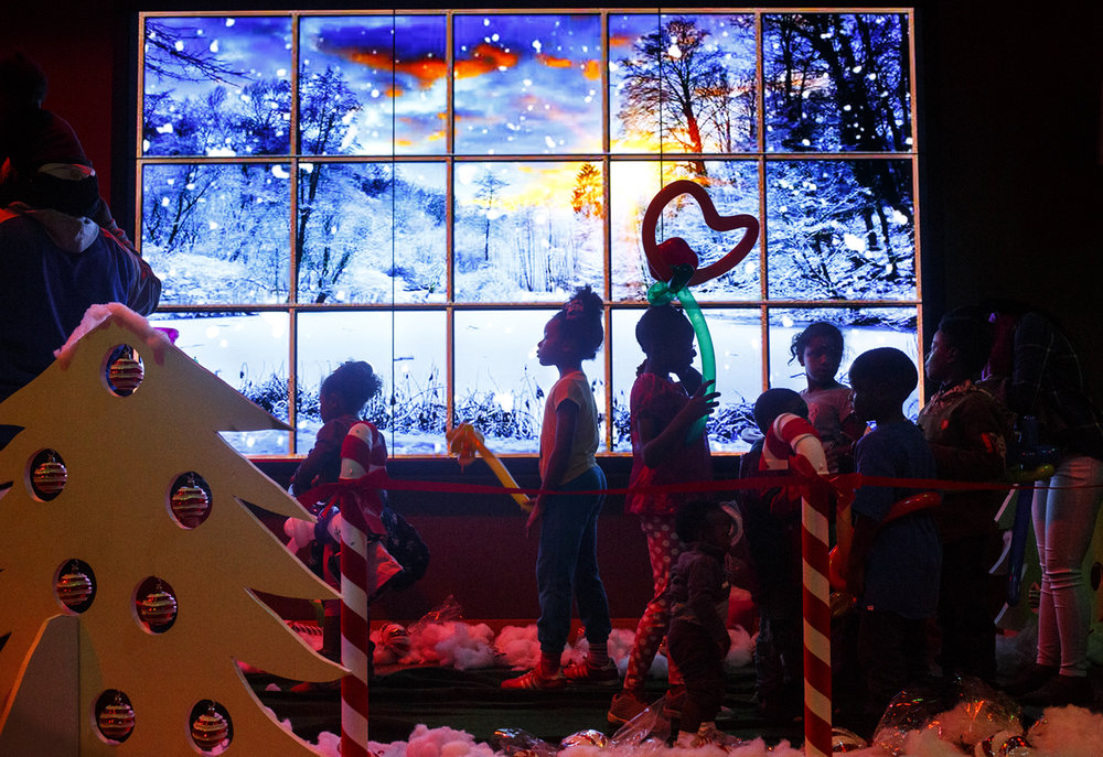 A line snakes past a winter scene on the big screen and through the life-sized Candy Land Adventure at the Abraham Lincoln Presidential Library Friday, Nov. 25, 2016. The adventure was part of the library's Fun Frosty Friday event, an alternative to Black Friday shopping which also included face painting, a magic show, art projects and an appearance by Santa. Rich Saal/The State Journal-Register