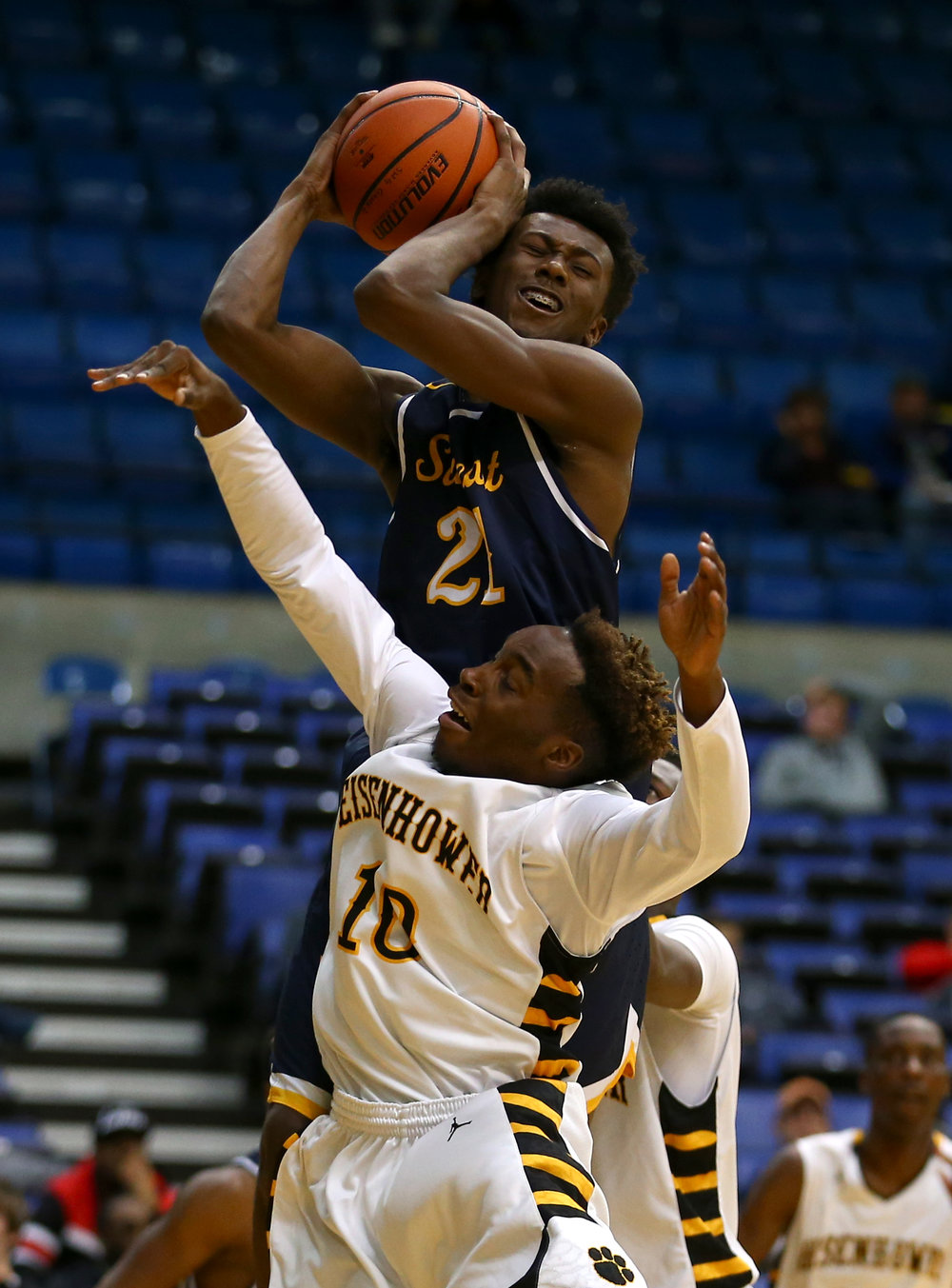 Southeast's Anthony Fairlee (21) comes down with a rebound against Decatur Eisenhower's Qualyn Young (10) in the first quarter during the Capital City Showcase Prairie Capital Convention Center, Saturday, Dec. 3, 2016, in Springfield, Ill. Justin L. Fowler/The State Journal-Register