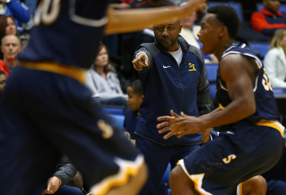 Southeast assistant coach Chuck Shanklin calls out positions for the Spartans as they try to press Decatur Eisenhower in the third quarter during the Capital City Showcase Prairie Capital Convention Center, Saturday, Dec. 3, 2016, in Springfield, Ill. Justin L. Fowler/The State Journal-Register