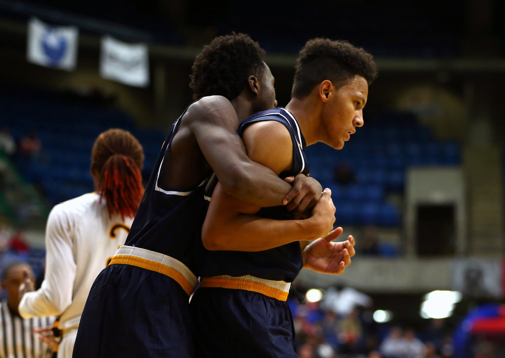 Southeast's Jordan Stapleton (15) is hugged by Southeast's Anthony Fairlee (21) after making a basket and drawing a foul against Decatur Eisenhower in the fourth quarter during the Capital City Showcase Prairie Capital Convention Center, Saturday, Dec. 3, 2016, in Springfield, Ill. Justin L. Fowler/The State Journal-Register