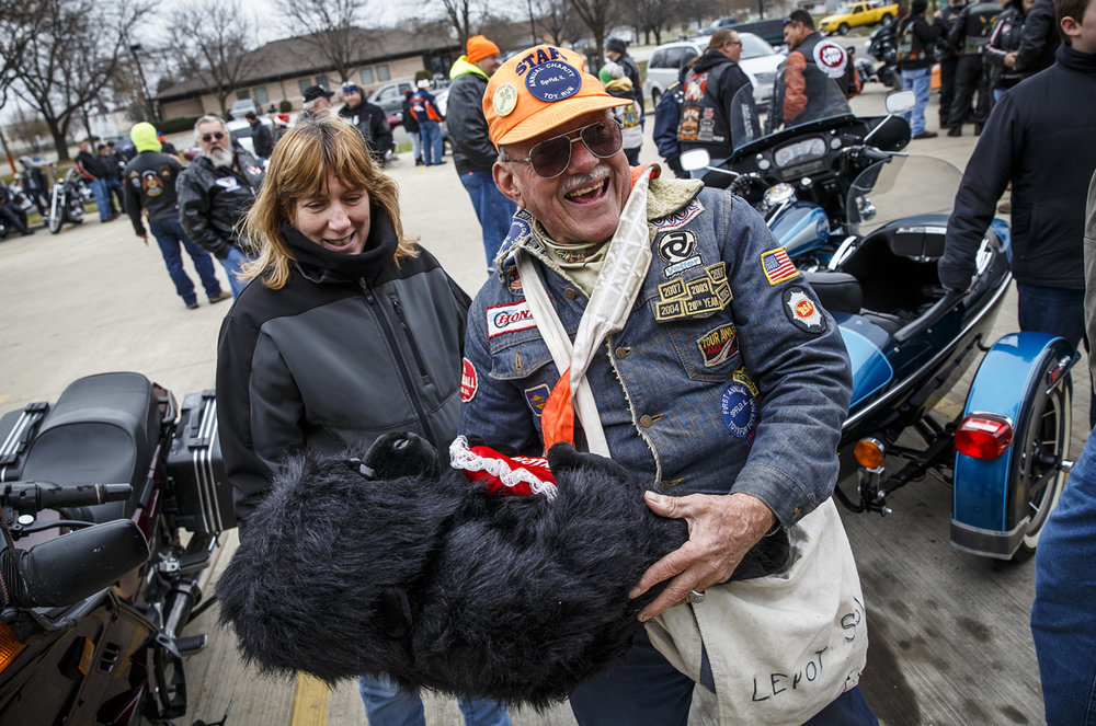Leroy Solomon, center, unloads a stuffed animal that he wanted Cindy Drum, of Contact Ministries, to find a home for during the 33rd annual Sid Wood Memorial Toy Run at Contact Ministries, Sunday, Nov. 27, 2016, in Springfield, Ill. Justin L. Fowler/The State Journal-Register