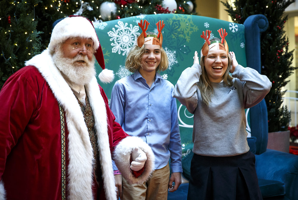 "Isaac Kinsel, 13, center, and his sister Maddy Kinsel, 17, right, react after saying yes to an oath from Santa Claus to help pull his sleigh if anything were to ever happen to the reindeer after having their picture taken with him for the 17th time for Maddy and the 13th time for Isaac at White Oaks Mall, Friday, Dec. 2, 2016, in Springfield, Ill. The siblings mother, Missy Kinsel, has had a tradition, despite their age, to take her children every year to the mall to have their picture taken with Santa Claus. ""I like to see the changes throughout each year,"" said Maddy Kinsel about the pictures of she and her brother throughout the years. ""Looking through each picture and seeing how different both Isaac and I look from each year is the best part of it.Ó Justin L. Fowler/The State Journal-Register"