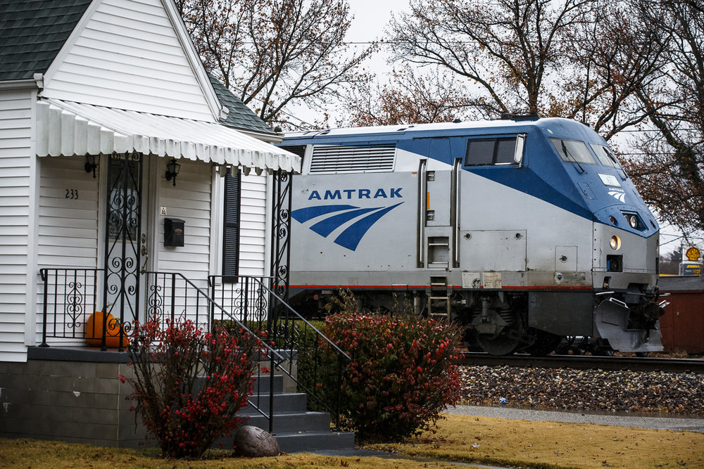 The Amtrak Lincoln Service #303 train heads south to St. Louis going through a residential area at South 3rd Street and East Pine Street, Monday, Nov. 28, 2016, in Springfield, Ill. The scaled back improvements on the Third Street rail line in Springfield qualify the corridor for a quiet zone of no train horns, according to a state summary of the project ahead of a public hearing on the work next week. Justin L. Fowler/The State Journal-Register