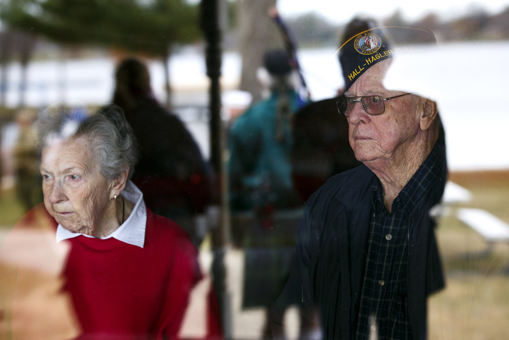 Kathy Smith and Harold Weaver, both World War II veterans, watch the wreath laying ceremony at Lake Springfield from the Disabled American Veterans Club Wednesday, Dec. 7, 2016 during the Pearl Harbor Remembrance Day 75th anniversary ceremony. Smith was a member of the WAVES (the women's branch of the Naval Reserves) and Weaver is a U.S. Army veteran who fought in the Pacific. Rich Saal/The State Journal-Register