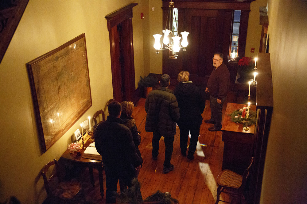 Logan McMinn, right, leads a tour of the Elijah Iles House during the annual candlelight open house of the historic home Friday, Dec. 9, 2016. The house is the oldest in Springfield and is decorated in the style of Christmas during different times in the 19th and 20th centuries.  The candlelight tours return Feb. 16 and 17 from 5-8 p.m. Rich Saal/The State Journal-Register
