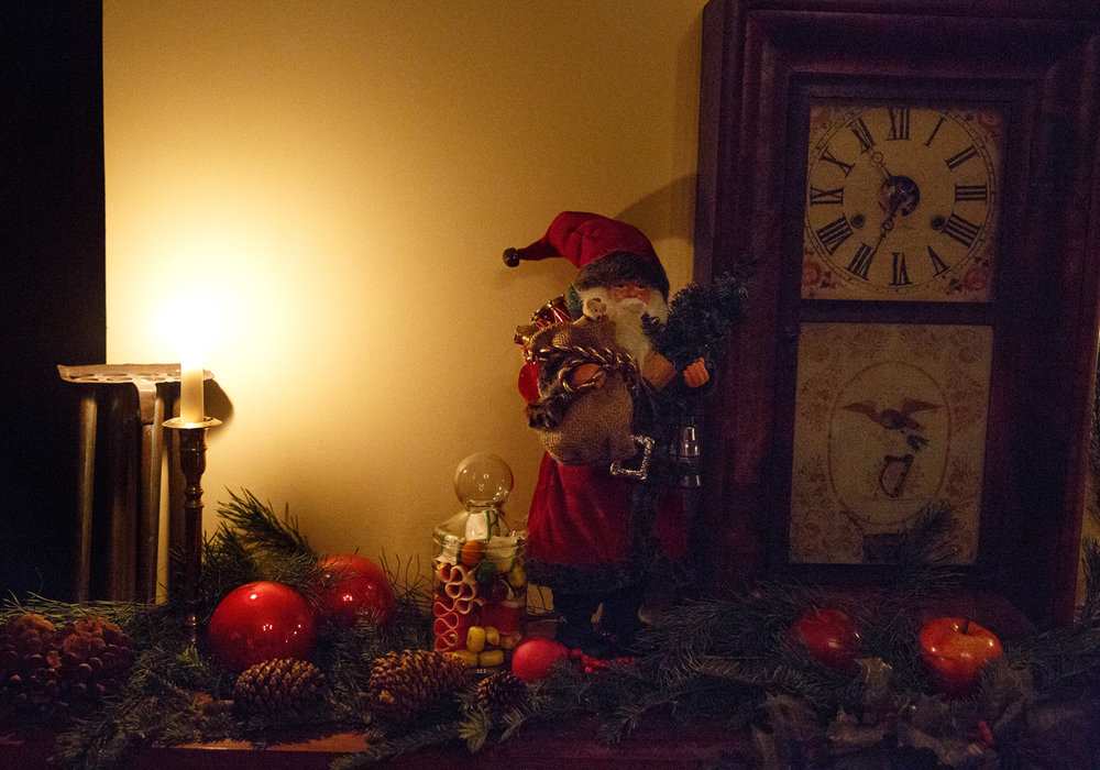 One of the decorated fireplace mantels in the Elijah Iles House during the annual candlelight tour of the historic home Friday, Dec. 9, 2016. The house is the oldest in Springfield and is decorated in the style of Christmas during different times in the 19th and 20th centuries.  The candlelight tours return Feb. 16 and 17 from 5-8 p.m. Rich Saal/The State Journal-Register