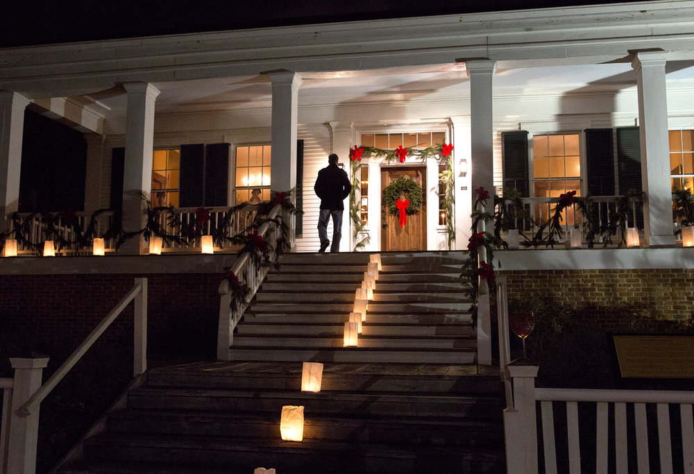Luminaria lead the way to the front door of the historic Elijah Iles House during its annual Christmas candlelight tour Friday, Dec. 9, 2016. Rich Saal/The State Journal-Register