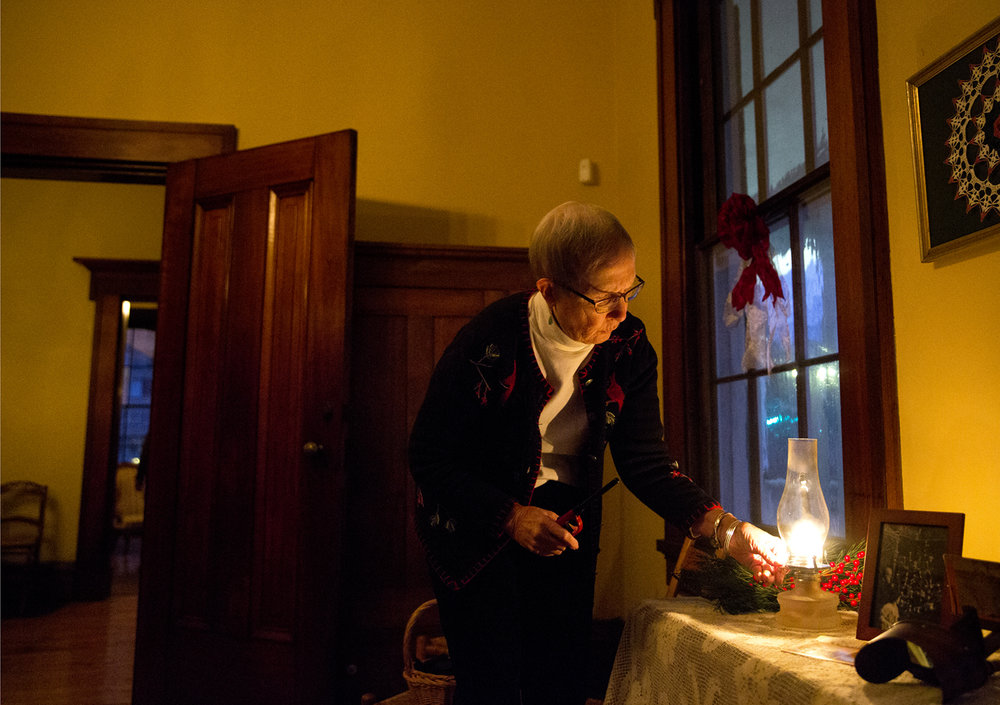 Mary Patton adjusts the flame in an oil lamp at the Elijah Iles House just before the doors open for the annual candlelight tour of the historic home Friday, Dec. 9, 2016. The home is the oldest in Springfield and is decorated in the style of Christmas during different times in the 19th and 20th centuries. The candlelight tours return Feb. 16 and 17 from 5-8 p.m. Rich Saal/The State Journal-Register