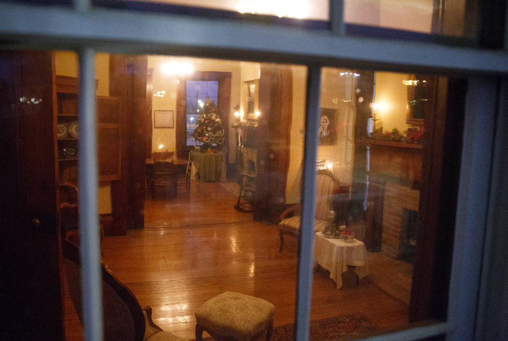 The Elijah Iles House viewed through a window from the front porch during the annual candlelight tour of the historic home Friday, Dec. 9, 2016. The house is the oldest in Springfield and is decorated in the style of Christmas during different times in the 19th and 20th centuries.  The candlelight tours return Feb. 16 and 17 from 5-8 p.m. Rich Saal/The State Journal-Register