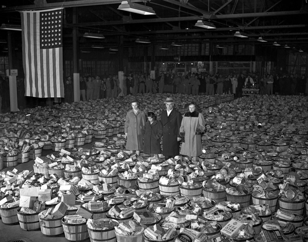 Gov. Dwight Green, his wife Mabel and daughters Nancy and Gloria, with governor's Christmas baskets before distribution from state garage Christmas eve, Dec. 24, 1941. File/The State Journal-Register